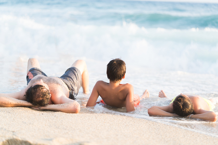 Family playing on summer sea beach