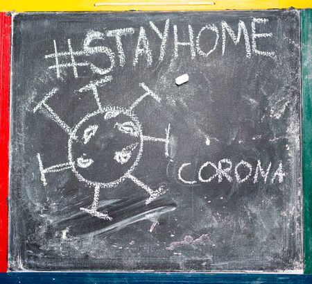 Corona virus sign on blacboard