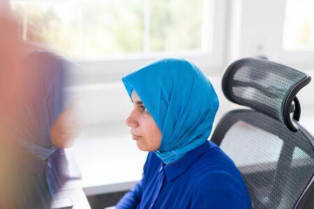 Muslim woman using technology for work Reklamní fotografie