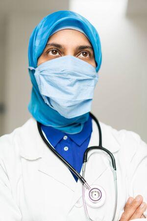 Muslim female doctor weaing protective mask