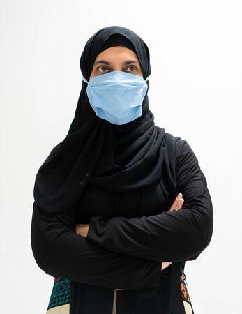 Muslim woman wearing mask against virus