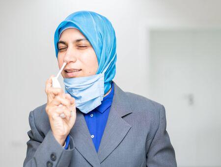 Muslim female doctor taking protective measures