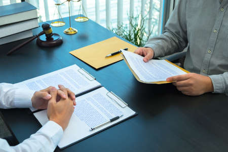 Lawyers or lawyers provide legal advice to clients regarding business law. Law in daily life. Stock Photo
