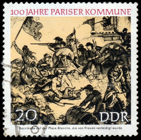defended: GERMANY- CIRCA 1971  stamp printed by Germany, shows Barricade at Place Blanche, defended by women, circa 1971   Editorial