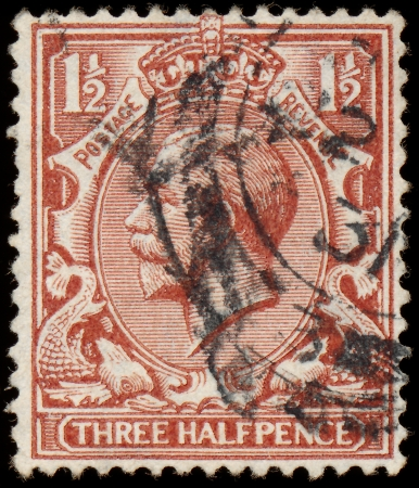 UNITED KINGDOM - CIRCA 1912 to 1924  An English Used Three Halfpence Brown Postage Stamp showing Portrait of King George V, circa 1912 to 1924