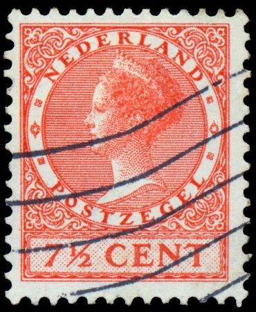 regnant: NETHERLANDS - CIRCA 1928  A stamp printed in Netherlands shows portrait of Queen Wilhelmina  1880-1962 , circa 1928
