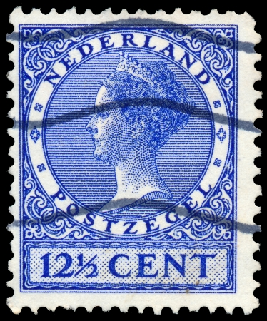 wilhelmina: NETHERLANDS - CIRCA 1928  A stamp printed in Netherlands shows portrait of Queen Wilhelmina  1880-1962 , circa 1928