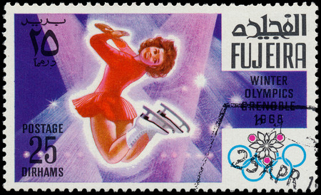 FUJEIRA - CIRCA 1968  A stamp printed in Fujeira shows women Editorial