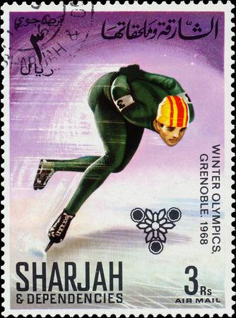sharjah: SHARJAH AND DEPENDENCIES - CIRCA 1968  stamp printed by Sharjah and Dependencies, shows Figure Skating, circa 1968