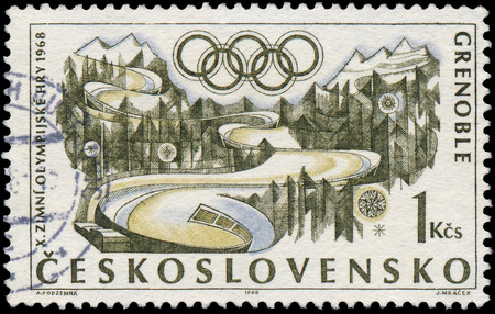 czechoslovakia: CZECHOSLOVAKIA - CIRCA 1968: a stamp printed in the Czechoslovakia shows Figure Skating and Olympic Rings, 10th Winter Olympic Games, Grenoble, France, circa 1968