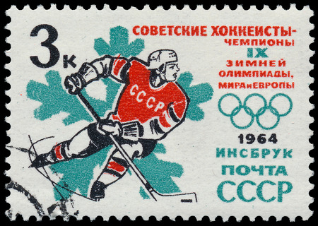 olympic symbol: USSR - CIRCA 1964: stamp printed in USSR shows Hockey with inscriptions Insbruck,1964 &So viet hockey players-champions of world, European and Olympics from series Winter Olympic Games, circa 1964  Editorial