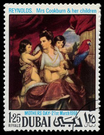 reynolds: DUBAI - CIRCA 1968: A stamp printed in Dubai shows painting of Sir Joshua Reynolds - Mrs. Cookburn and her children, series, circa 1968
