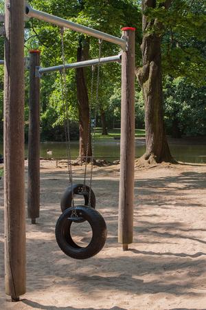 Image of children swing set in green park