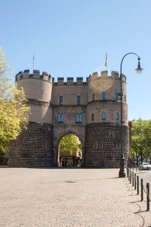 Cologne, North Rhine-Westphalia, Germany.June 2018.Medieval city gate with two round towers, part of the old city defense wall of Cologne Editorial