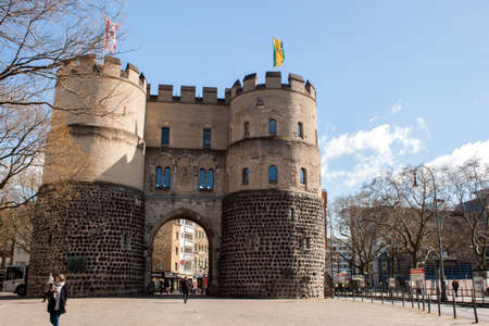 Cologne, North Rhine-Westphalia, Germany.March 2018.Medieval city gate with two round towers, part of the old city defense wall of Cologne