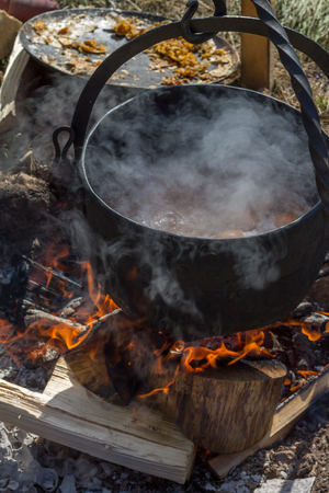 boiling pot: Cooking in the camp outdoor.  Boiling pot on the fire with eggs