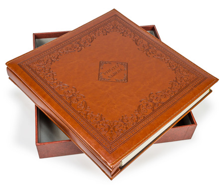 photo album cover: Brown leather photo album cover with decorative frame  , isolated white background
