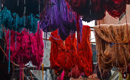 fes: Colored dyed yarn is dried on the streets of Morocco in Fes Stock Photo