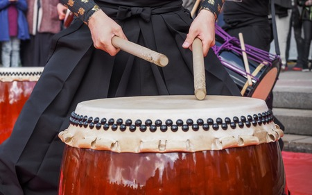 doubleheaded: Musicians play drums outdoors. Culture of Korea, Japan, China