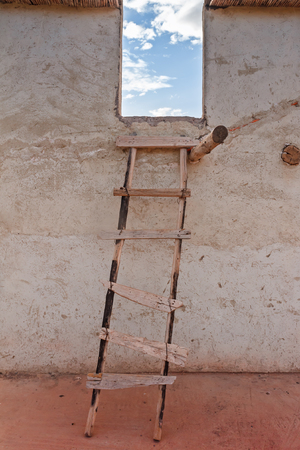 rungs: Old wooden ladder near the house in Morocco.