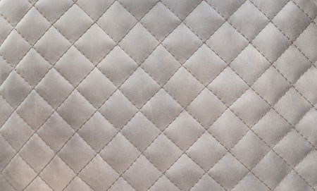 upholstered: Texture of genuine leather upholstered furniture. Decorative background Stock Photo