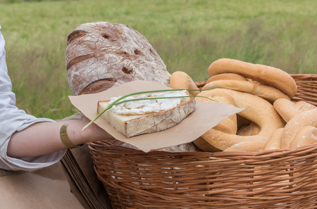 in the open air: People put pate on hearth bread from pot. Open air Stock Photo