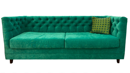 divan: Green sofa with pillow. Soft emerald couch. Classic divan on isolated background. Foto de archivo
