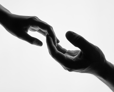 Finger Touching hands silhouette man woman white background couple feeling love. Man woman hold hands silhouette white background. Couple Holding Hands Closeup. Black and white photo