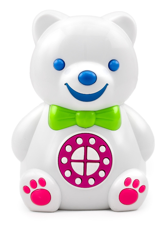 Electronic interactive childrens toy speaker bear with the control panel buttons on isolated background