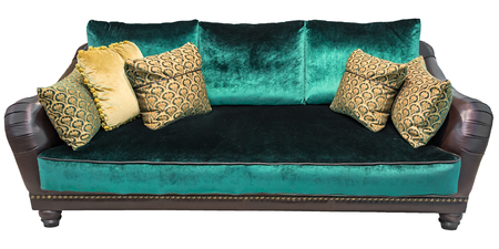 Green sofa with pillow. Soft emerald couch. Isolated background.