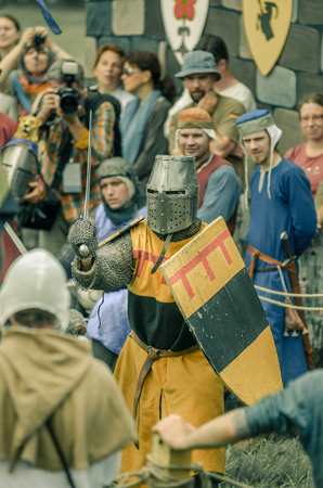 soldiers: RITTER WEG, MOROZOVO, APRIL 2017: Festival of the European Middle Ages. Medieval joust knights in helmets and chain mail battle on swords with shields in their hands.