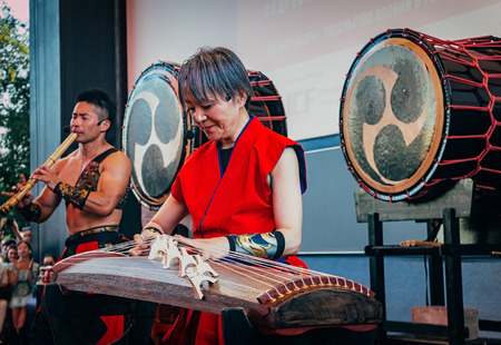 Moscow, Russia - July 16, 2017: Musicians ASKA-GUMI play the taiko drums, shakuhachi and koto on scene during the japanese festival.