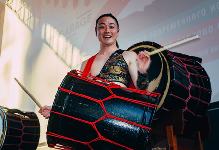 16: Moscow, Russia - July 16, 2017: Musicians ASKA-GUMI play the taiko drums on scene During the japanese festival.