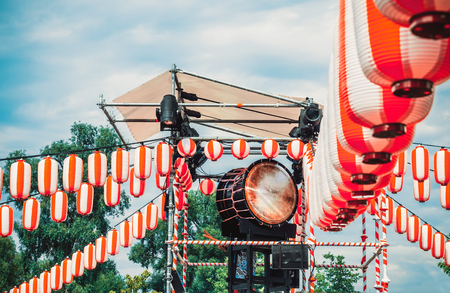 Japanese drum Taiko on the stage of the Yaguro. Paper red-white lanterns Chochin Scenery for the holiday Obon.