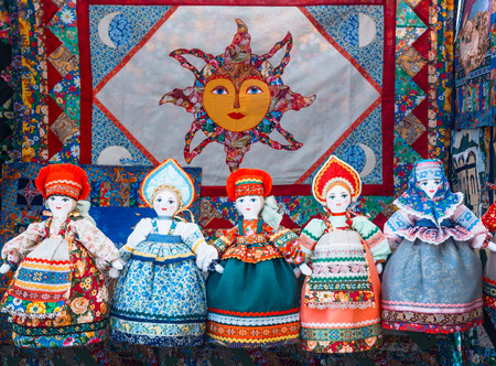 Slavic rag doll. Handmade rag doll woman, in traditional ethnic russian costume. Souvenirs from Russia.