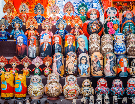 Colorful Russian nesting dolls Matryoshka at the market. Russian Santa Claus Ded Moroz, different Policies ets.
