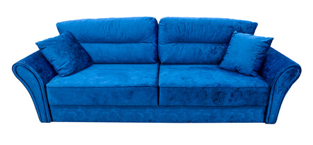Blue sofa. Soft velour fabric couch. Classic modern divan on isolated background Stock Photo