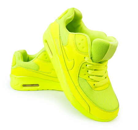light green sneakers isolated white background. sports shoes isolate
