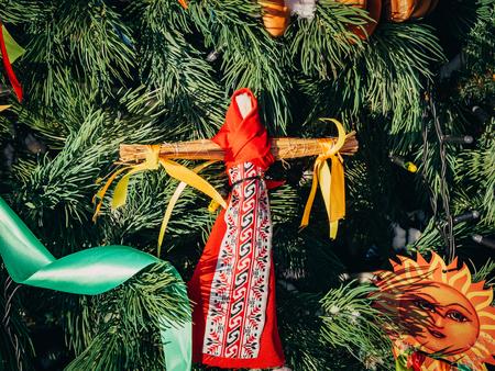 Rag Dolls on christmas tree on folk Slavic pagan holiday Maslenitsa of the end of winter.