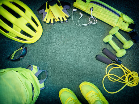 Sports kit background. Set of sports equipment with empty space in the center. Cycling, running, jumping on the ramp Stock Photo