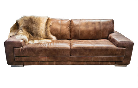 Brown leather sofa with animal skin isolated white background.