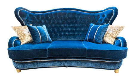 Blue velours sofa with pillows. Soft luxury classical couch with cushions isolated background Stock Photo