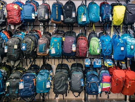 Moscow, Russia - September 6, 2018: Shop window with various backpacks. Hiking sports travel tourist backpacks sold in a sports store. Sports background Фото со стока - 137807245