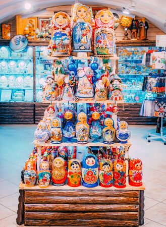 MOSCOW, Russia - December 19, 2018: Pyramid of colorful rainted russian nesting dolls Matryoshka at the market. Russian Father Frost or Ded Moroz, different Policies ets Editorial