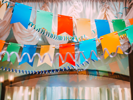 New Year Background. Classical Vintage Soviet New Years decorations: serpentine, garlands, flags on the background of curtains with fringe