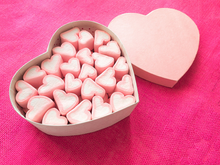 Pink marshmallow in a gift box in form of heart on textile background, Many hearts marshmallows for present, Sweets in the form of hearts of marshmallow. Valentines Day Gift