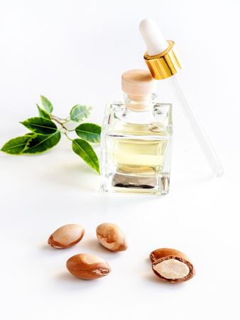 Bottle with oil argan nuts. Cosmetic means. Food product. Jar with argan oil on the isolated background