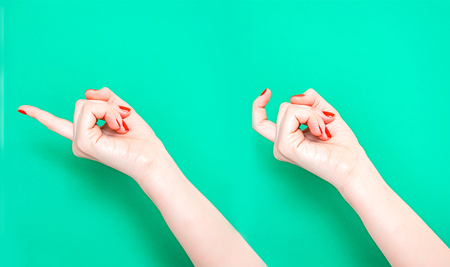The Come Hither Hand Sign. Woman hand beckoning on isolated turquoise green color background. Female hand beckoning isolated on white background. Woman gesturing with one finger, come here symbol.