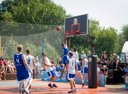 Moscow, Russia - August 4, 2018: Team playing basketball in the Gorky Park in summer. Basketball player throws the ball into the basketball hoop Redakční
