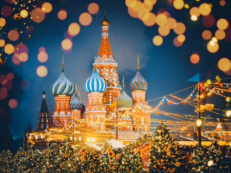 St. Basils Cathedral or Cathedral of Vasily the Blessed or Cathedral of the Intercession of the Most Holy Theotokos on the Moat or Pokrovsky Cathedral. Moscow Kremlin on decorated Red Square. Chrismas